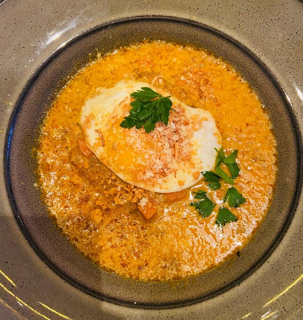 Cornbread & Gravy with chorizo, fried egg from Red Roaster - Harlem.